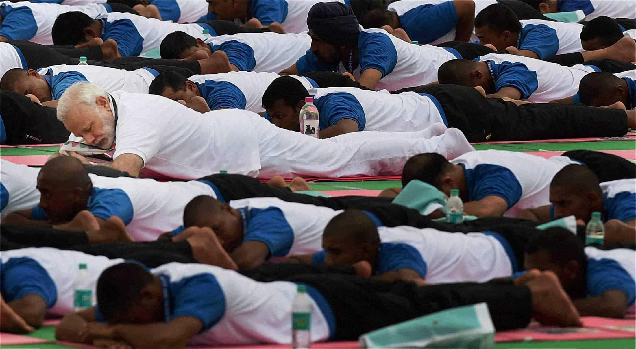 Prime Minister Narendra Modi, laid down his yoga mat among thousand others and practiced yoga. PTI