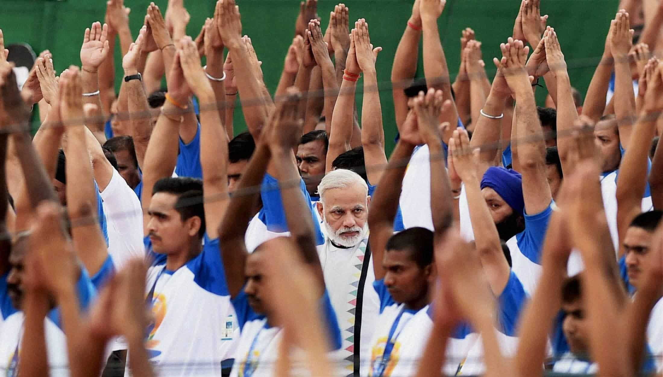 PM Modi spotted among thousand yoga practitioners in Capitol Complex, Chandigarh. PTI