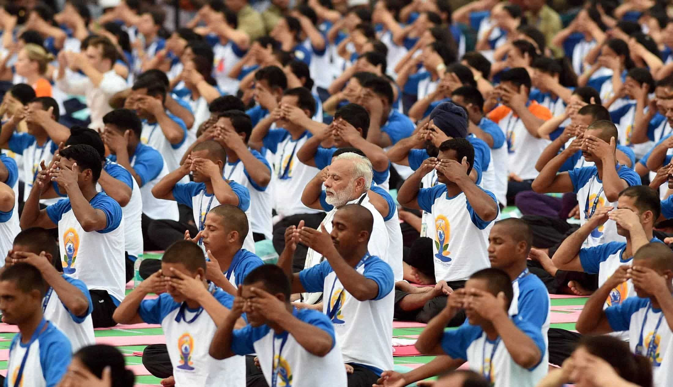 Once again PM Narendra Modi spotted amidst thousand yoga practitioners on second International Yoga Day event at Chandigarh. PTI