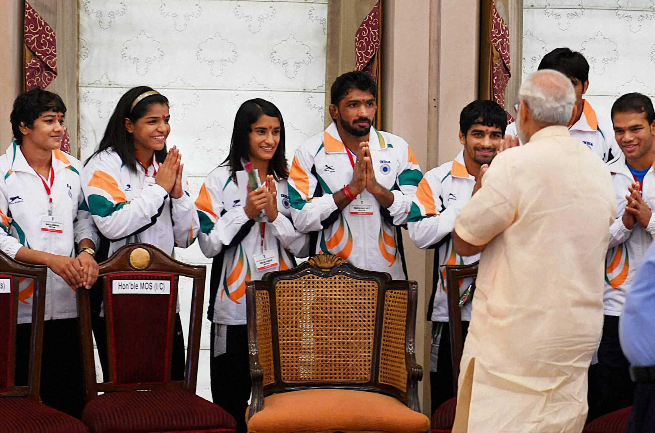Prime Minister Narendra Modi meets the athletes and sportspersons in New Delhi. PTI