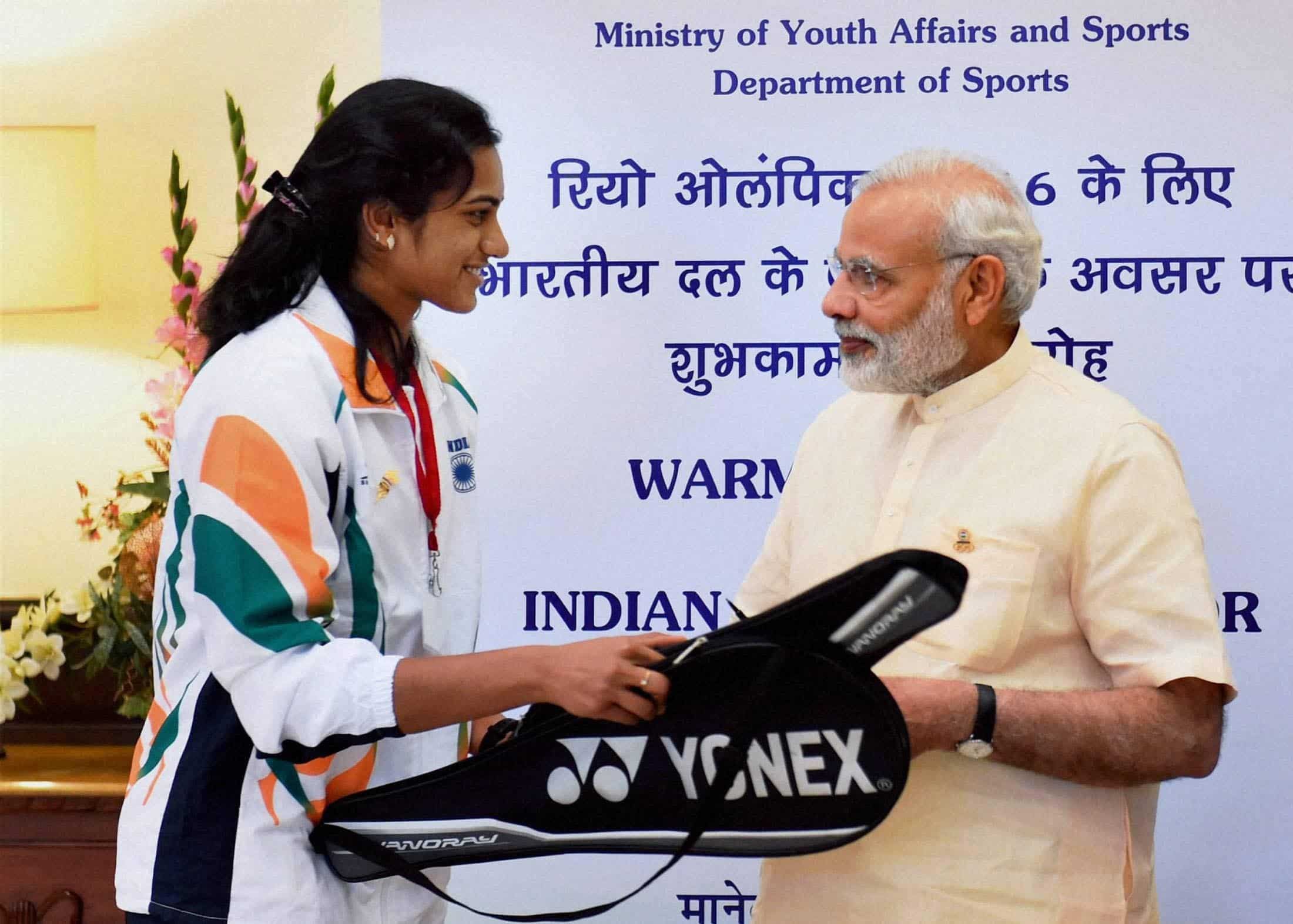 Badminton player, P V Sindhu shakes hands with PM Modi. PTI