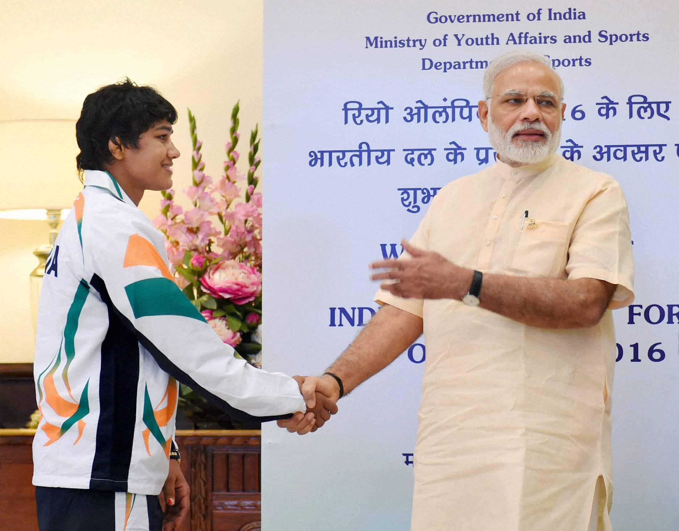 Prime Minister Narendra Modi shakes hands with wrestler Babita Kumari. PTI