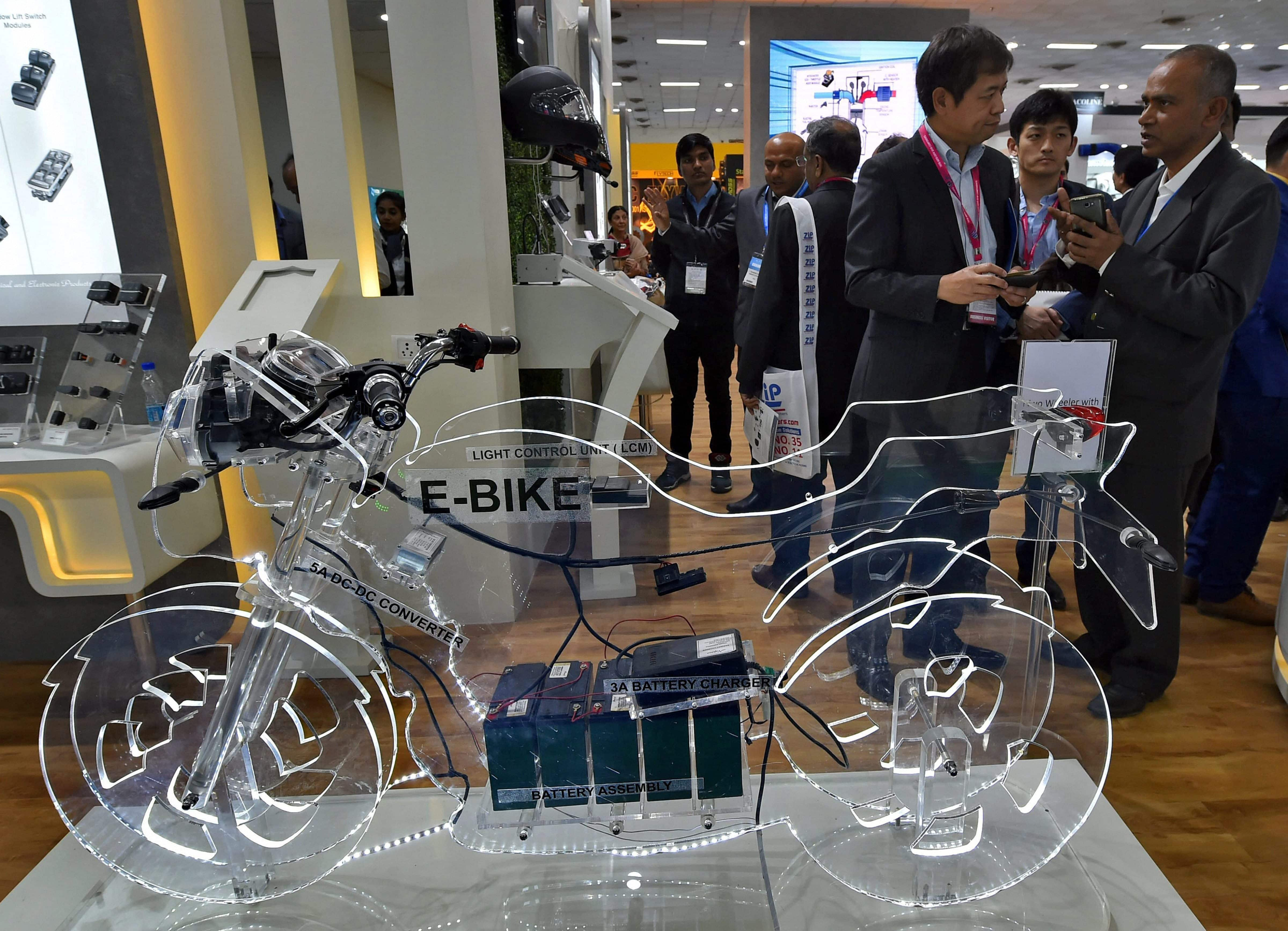 Delegates at a stall at the Auto Expo Component 2018 that began at Pragati Maidan in New Delhi on Thursday. PTI