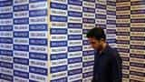 Reliance Communications ratings under review for downgrade despite Brookfield deal, Moody's; shares flat