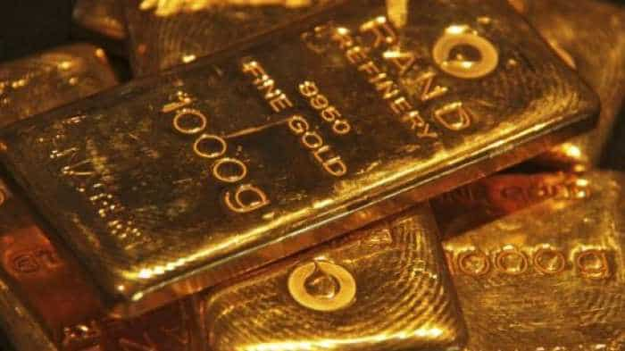 Gold futures up Rs 12 on global cues