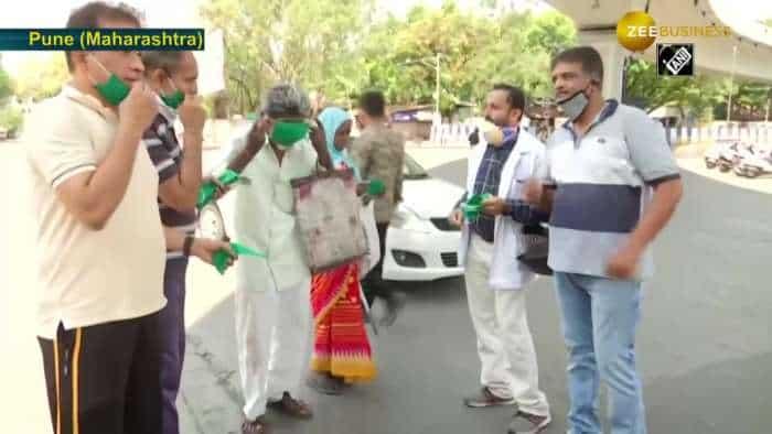 Doctors distribute reusable masks on Pune streets