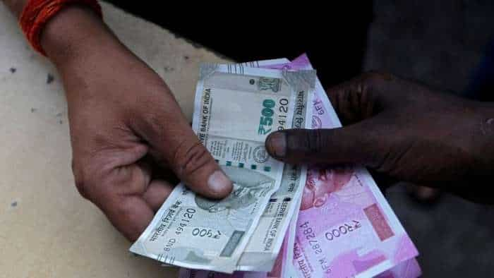 Rupee gains 11 paise to end at 74.92 against US dollar