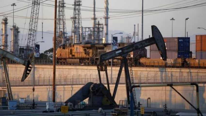 Crude oil futures rise on weaker dollar, new cash inflows