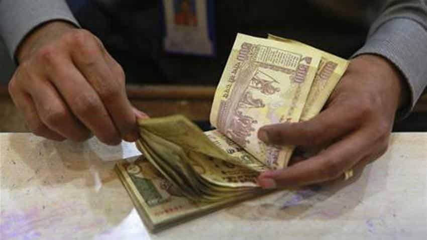 Rupee opens 8 paise lower against dollar at 66.41