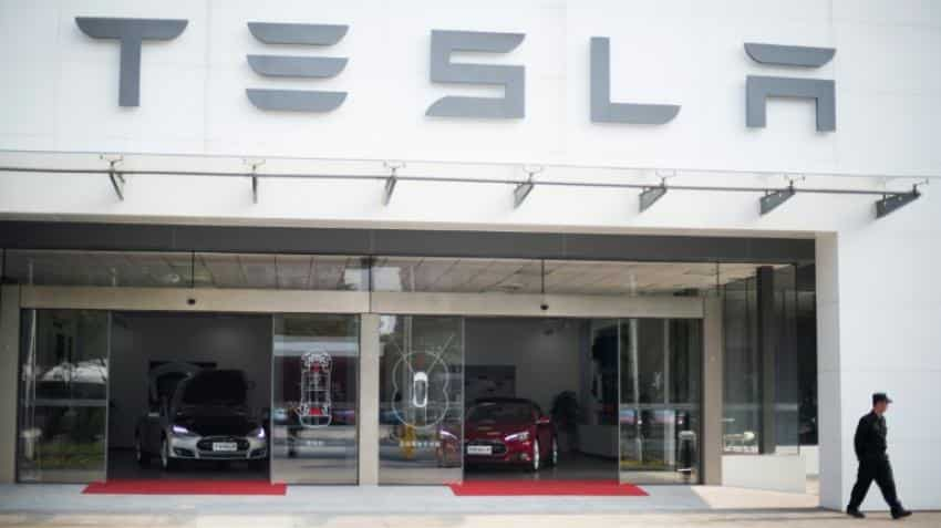 Tesla accelerates to hit target of 500,000 cars yearly