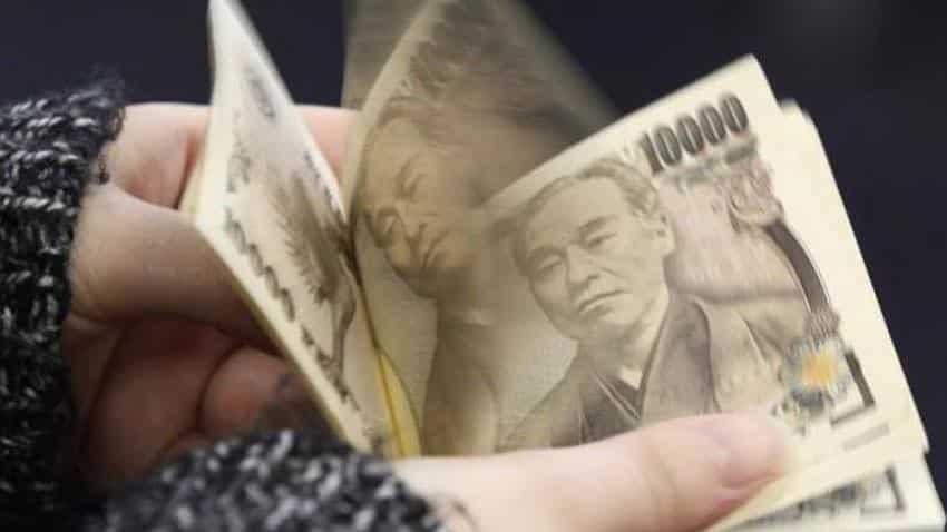 Yen falls near two-week lows after Japan's verbal warnings