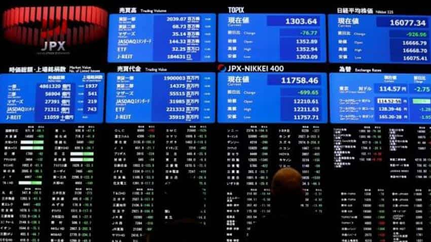 Asian shares rise, but Japan stocks fall on weak economic data