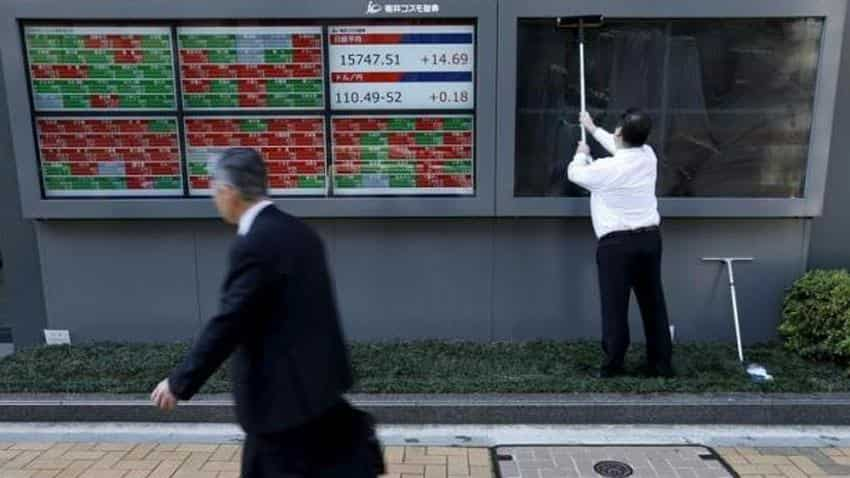 Asian shares edge up, Kiwi rises as central bank keeps interest rates unchanged