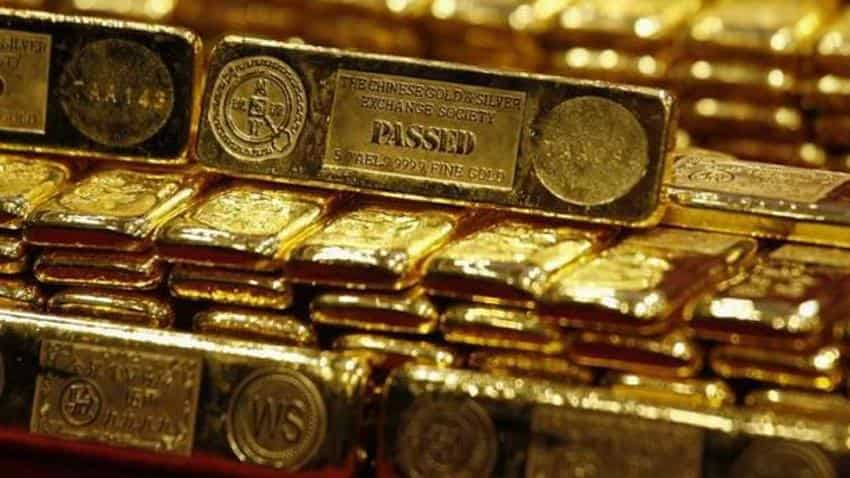 Gold edges up in early trade, set for third straight weekly gain