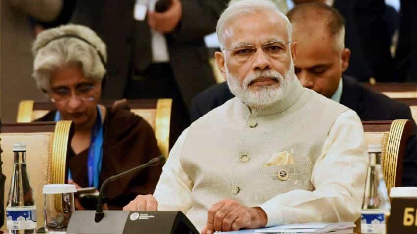 PM Modi breaks his silence; defends Rajan against Swamy
