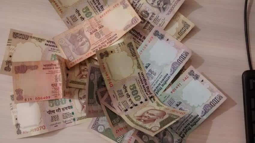 Rupee slumps 8 paise against dollar
