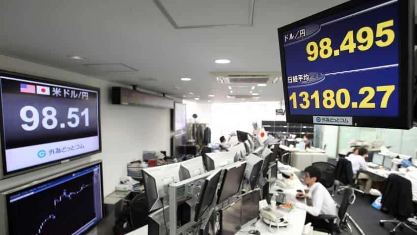 Asian markets near nine-month highs as dollar edges up