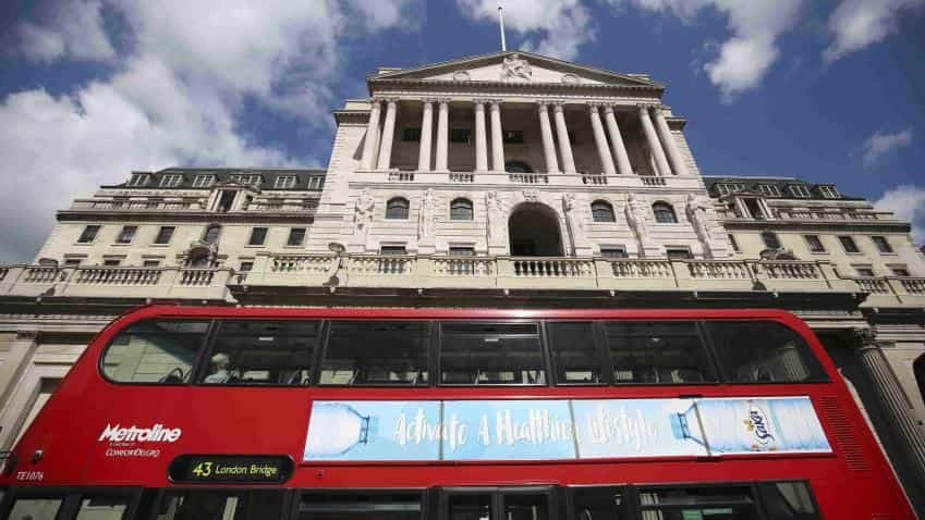 Bank of England cuts rates for first time since 2009, restarts bond purchases