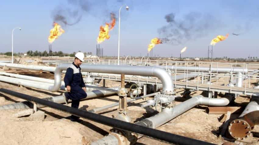 Oil prices fall over 1% on surge in dollar