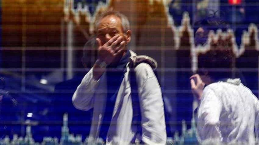 Asian shares rise as investors hunt for yield on positive US data