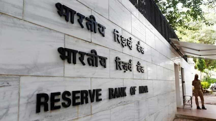 RBI soaking foreign inflows to curb impact on rupee, Rajan says