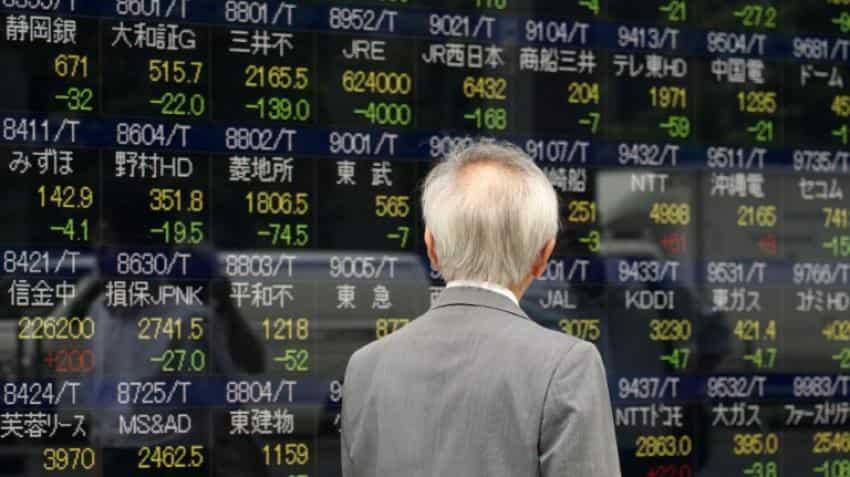 Tokyo stocks lead Asia down as yen strengthens