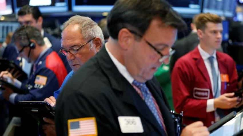 Wall Street opens flat as Feds divided on rates