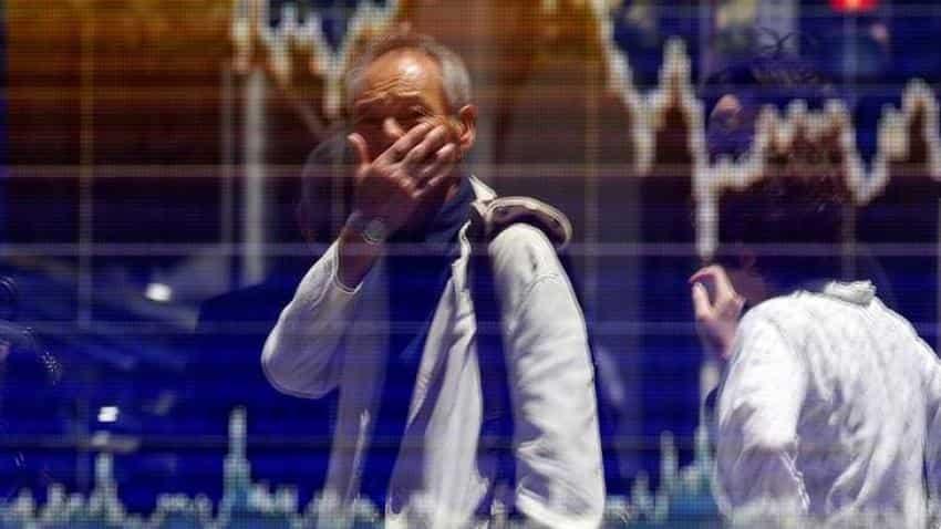 Asian stocks edge up, dollar dips as markets await Fed clues