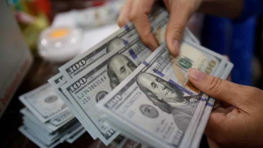 Dollar edges up, as investors wait on US Fed, Jackson Hole