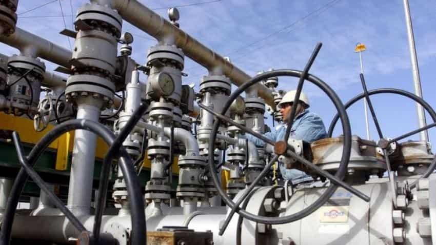 Crude oil falls towards $49 per barrel on high output, strong dollar