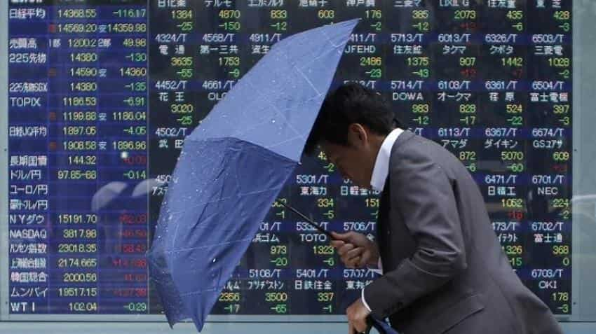 Asian shares bounce, dollar dips on Fed rate hike doubts