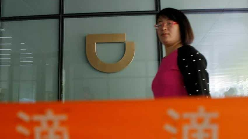China's government flexes muscles with Uber, DreamWorks probes