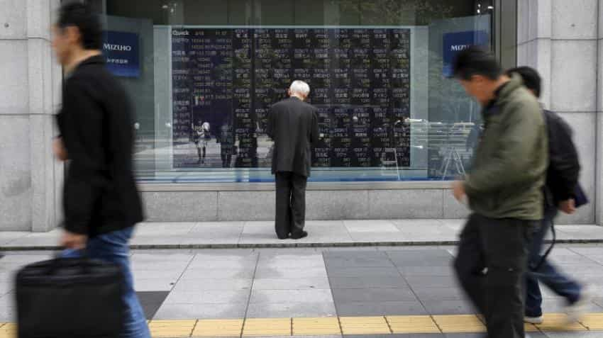 Asian shares near one-year top as investors await China trade data