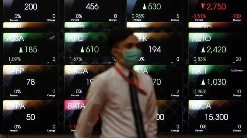 Asian stocks up as weak US data crimp Fed hike chances