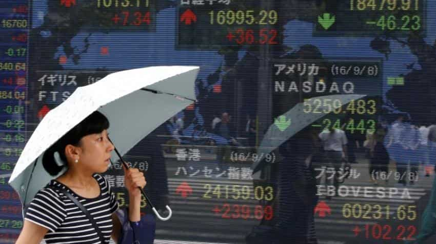 Asian markets rise before central bank meetings in US, Japan