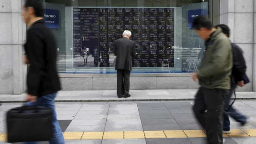 Asian stocks waver as investors await US Fed, Bank of Japan meet