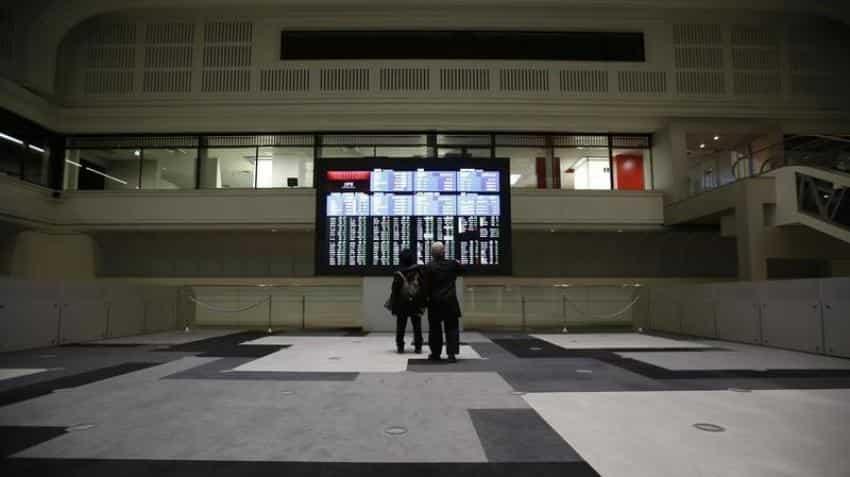 Asian stocks rise; investors cautious ahead of BOJ verdict