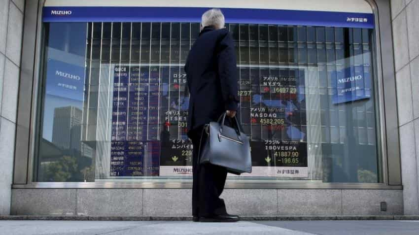Asian shares rally as US Fed keep rates unchanged