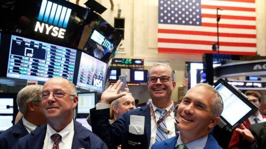 Nasdaq hits record high after US Federal Reserve keeps rates unchanged
