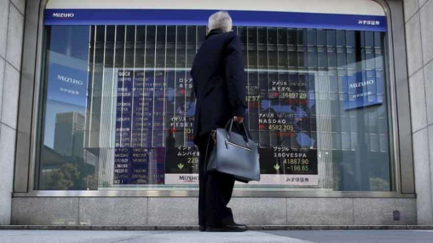 Asian shares gain as crude oil surge improves risk appetite