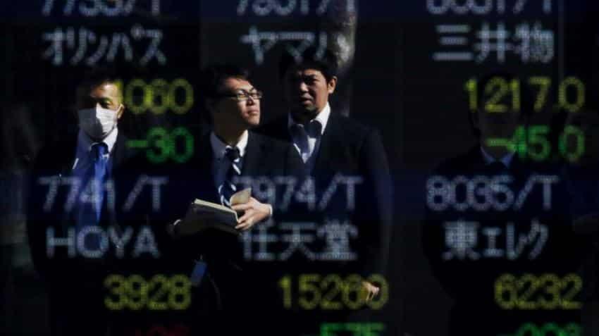 Asian shares wobble, dollar firms after upbeat U.S. data