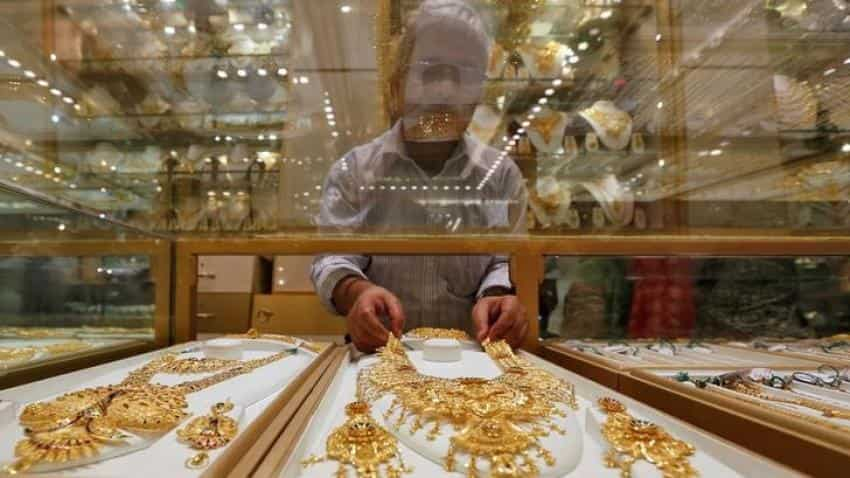 Gold holds losses on firm dollar after positive US data
