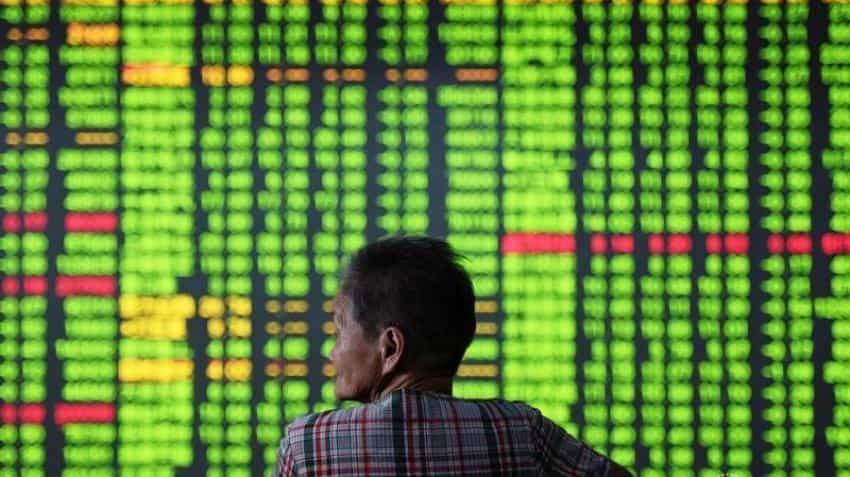 'Fat-finger' error seen as sterling slumps; Asian shares dip