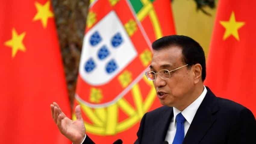China premier says economy improving, debt risks under control