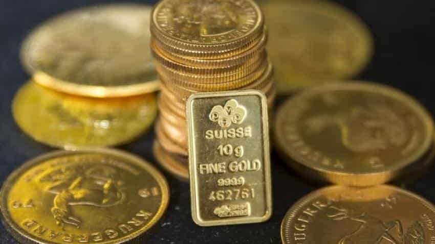 Gold treads water, possible U.S. rate hike in focus