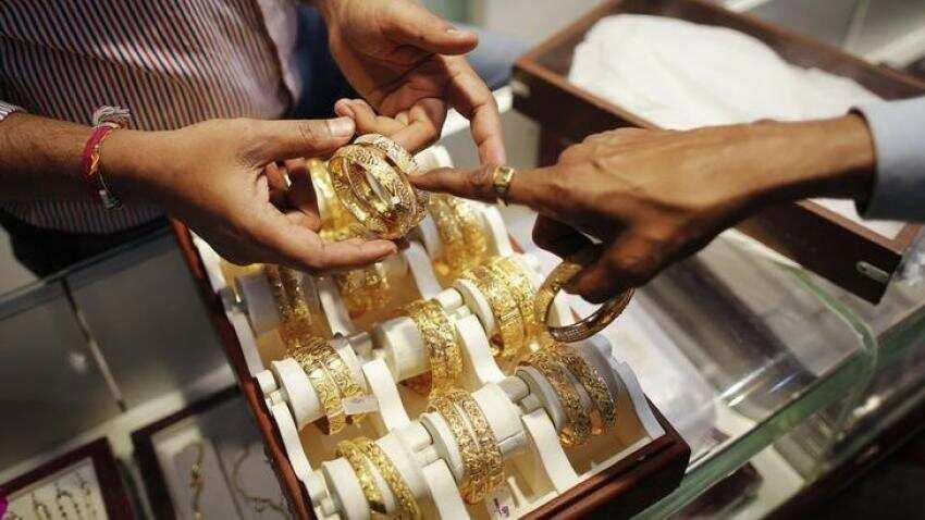 Gold steady on weaker dollar, firmer stocks cap gains