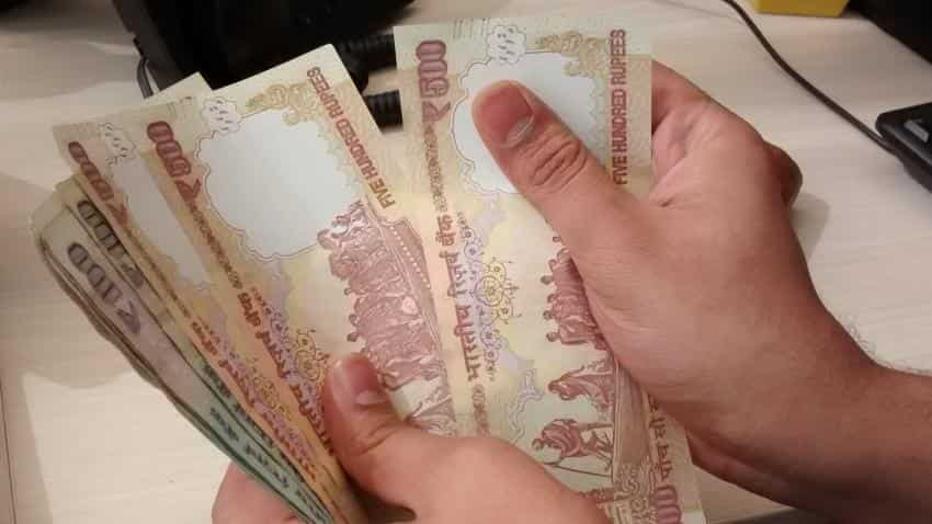 Rupee runs higher by 12 paise against dollar