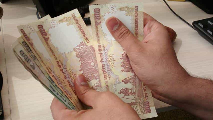 Rupee falls further by 13 paise against dollar in early trade