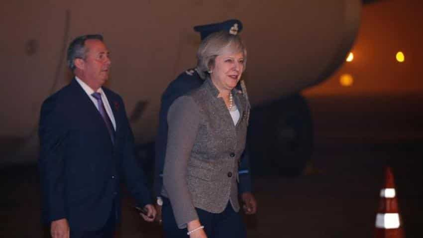 Theresa May, in India, says UK to be free trade advocate