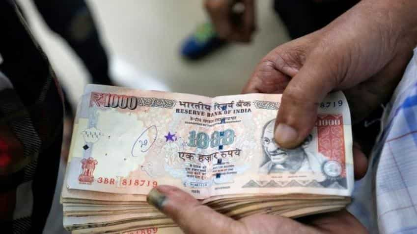 Opposition parties slam government's move to abolish large currency notes